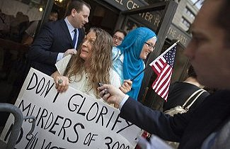 Linda Rivera holds a sign in protest of a mosque construction near Ground Zero after NYC's Landmarks Commission vote to not grant landmark status to 45-47 Park Place on August 03, 2010 in New York City. The commission's decision clears the way for the property to be converted into a mosque and community center.